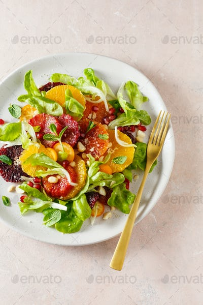 Fruit salad with blood oranges, nuts and pomegranate seeds