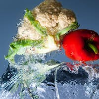 Red and yellow peppers and cauliflower in water
