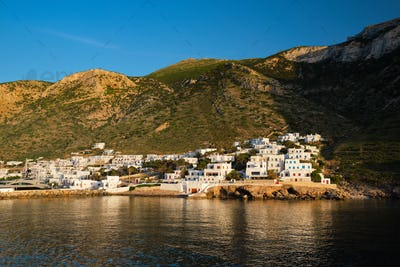 Kamares town with traditional white houses on Sifnos island on sunset. Greece