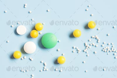 Various Pills on the Blue Background