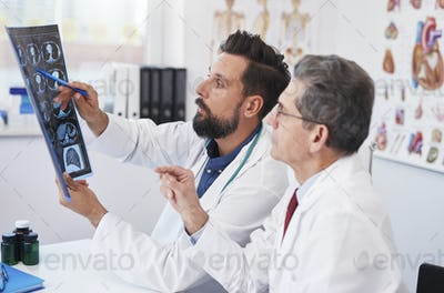 Two doctors consult the X-ray Image