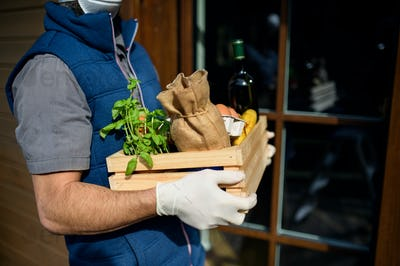 Courier delivering fresh fruit and vegetables shopping, corona virus and quarantine concept
