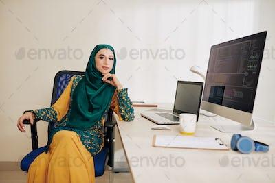 Confident muslim female software developer