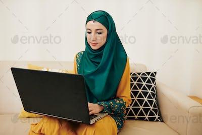 Female freelancer working on laptop