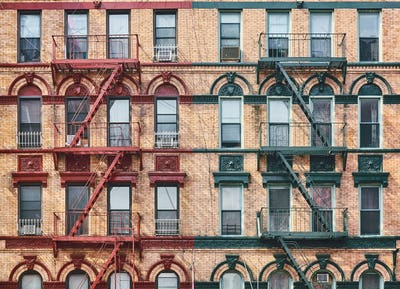 Manhattan old residential building with fire escapes, New York.