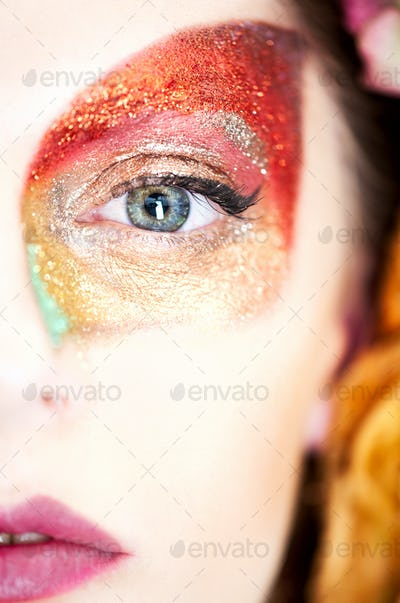 beauty makeup portrait of half a face of a young woman, with an