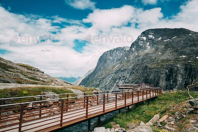 Trollstigen, Andalsnes, Norway. People Tourists Walking Visiting Viewing Platform Near Visitor