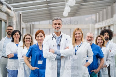 Group of doctors standing in hospital on medical conference.