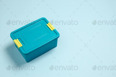 Closed lunch box. Monochrome stylish composition in blue color. Top view, flat lay