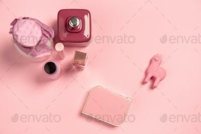 Cosmetics, fashion. Monochrome stylish composition in pink color. Top view, flat lay