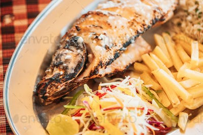 Goa, India. Fried European Bass With Potatoes And Salad On Dish