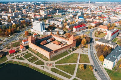 Lida, Belarus. Aerial Bird's-eye View Of Cityscape Skyline. Lida Castle In Sunny Autumn Day