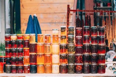 Various Jars With Sweet Tasty Yummy Jams. Jam Made From Walnuts, Pine Cones, Walnuts, Honey