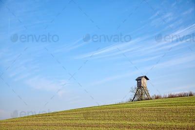 Farmland with hunting blind.