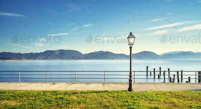 Massaciuccoli lake, terrace, street lamp and pier remains. Torre del Lago Puccini Versilia Italy