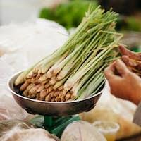green onionon scales at market for sale