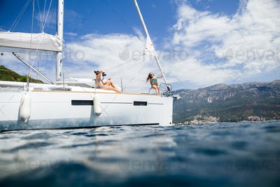 girls yachting and photograph sea cruise vacation