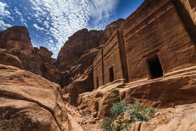 Old buildings of ancient Petra in the background of blue sky. Jordan