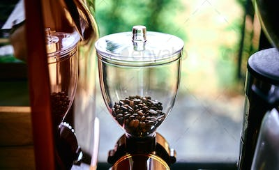Close-up view of coffee grinder in a coffee shop