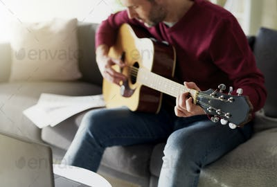 Man having first lesson with acoustic guitar