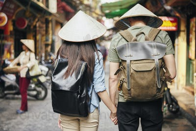 Back view of tourist with backpack exploring the city