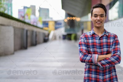 Young handsome Indian man exploring the city of Bangkok, Thailan
