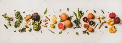 Variety of colorful immunity boosting plant foods over white background