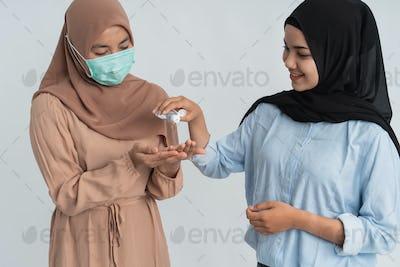 woman applying antibacterial hand sanitizer