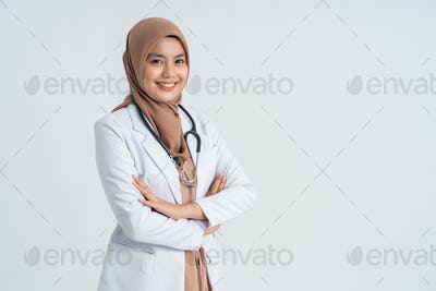 muslim beautiful female doctor in white coat with stethoscope