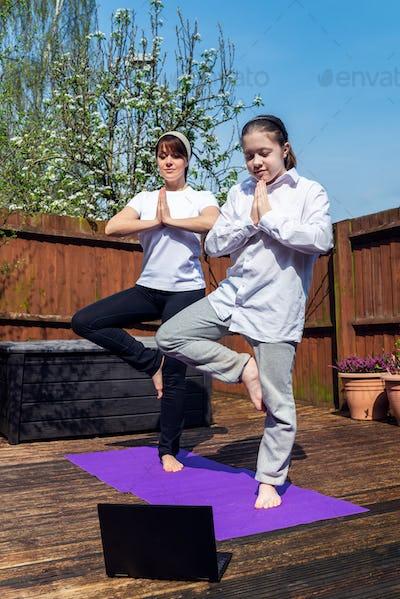Woman is doing online yoga