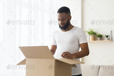 Sad african american millennial guy received wrong order