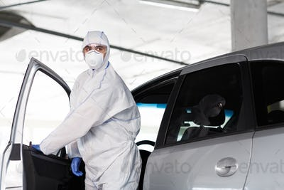 Man in hazmat suit get out of the car, coronavirus
