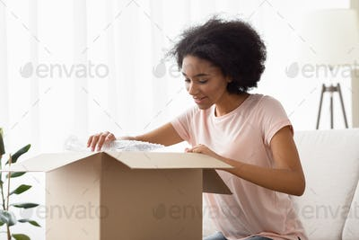 Girl with big box of purchases from online store