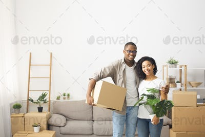 Young couple moving to a new apartment