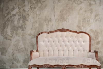 Classic wooden chairs with a comfortable cream color with arm chairs
