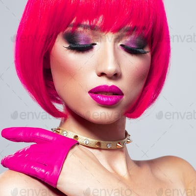 Glamour fashion model with bright make-up, at studio.