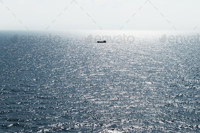 Lonely fishing ship trawler boat on ocean