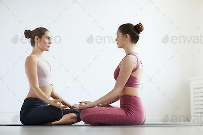 Women relaxing during yoga
