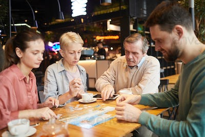 Family playing in board games