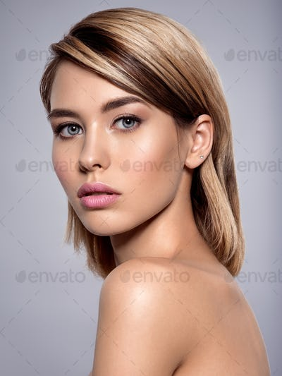 Close-up portrait of sexy caucasian young woman with beautiful blue eyes.