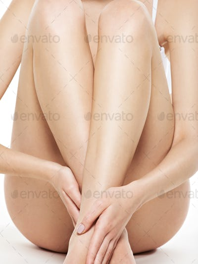 Woman legs isolated on white background