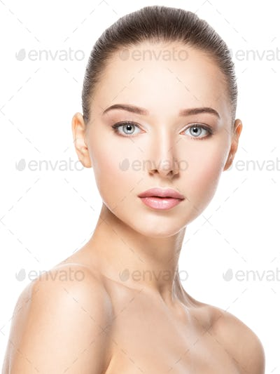 Beautiful face of young woman with healthy clean skin