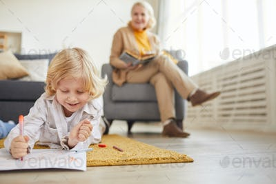 Little boy drawing on the floor