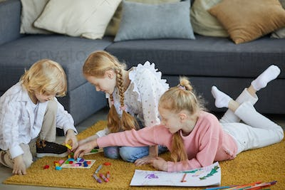 Children playing with blocks at home