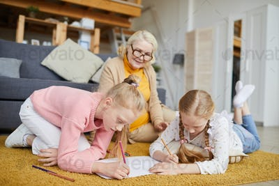 Little girls drawing at home