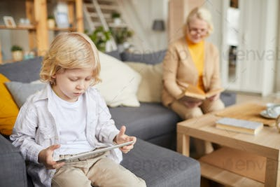 Little boy playing in tablet pc