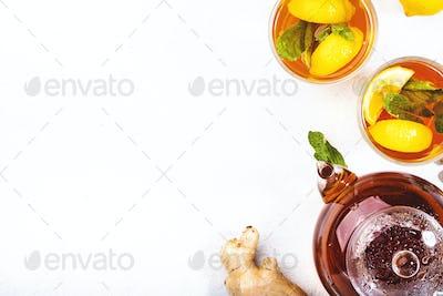 Healing black herbal tea with ginger, honey, lemon and mint