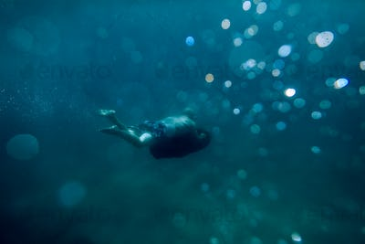 man swim underwater