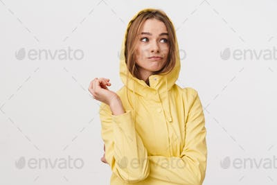 Photo of confused caucasian woman posing and looking aside
