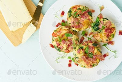 Egg muffin baked with bacon, ketogenic keto diet, pastel modern top view